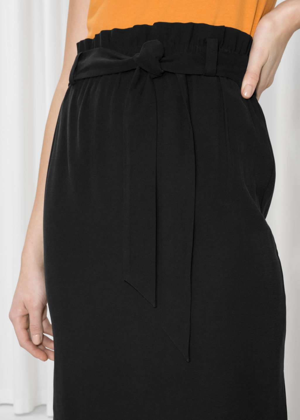 Detailed image of Stories paperwaist skirt  in black