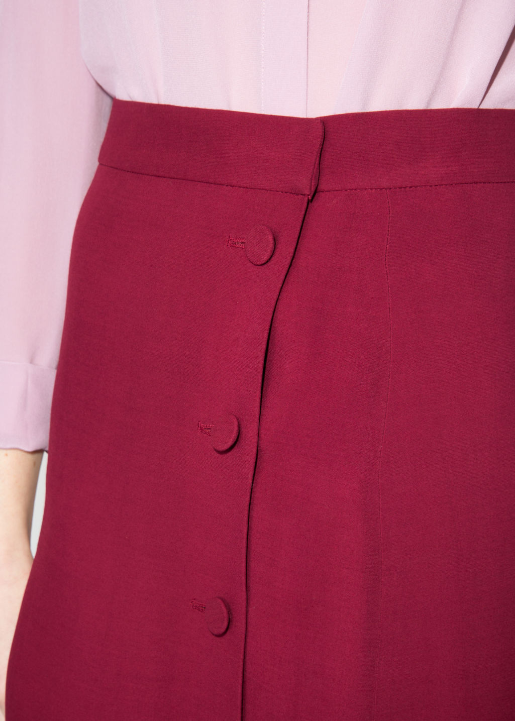 Detailed image of Stories high waist side button skirt in red