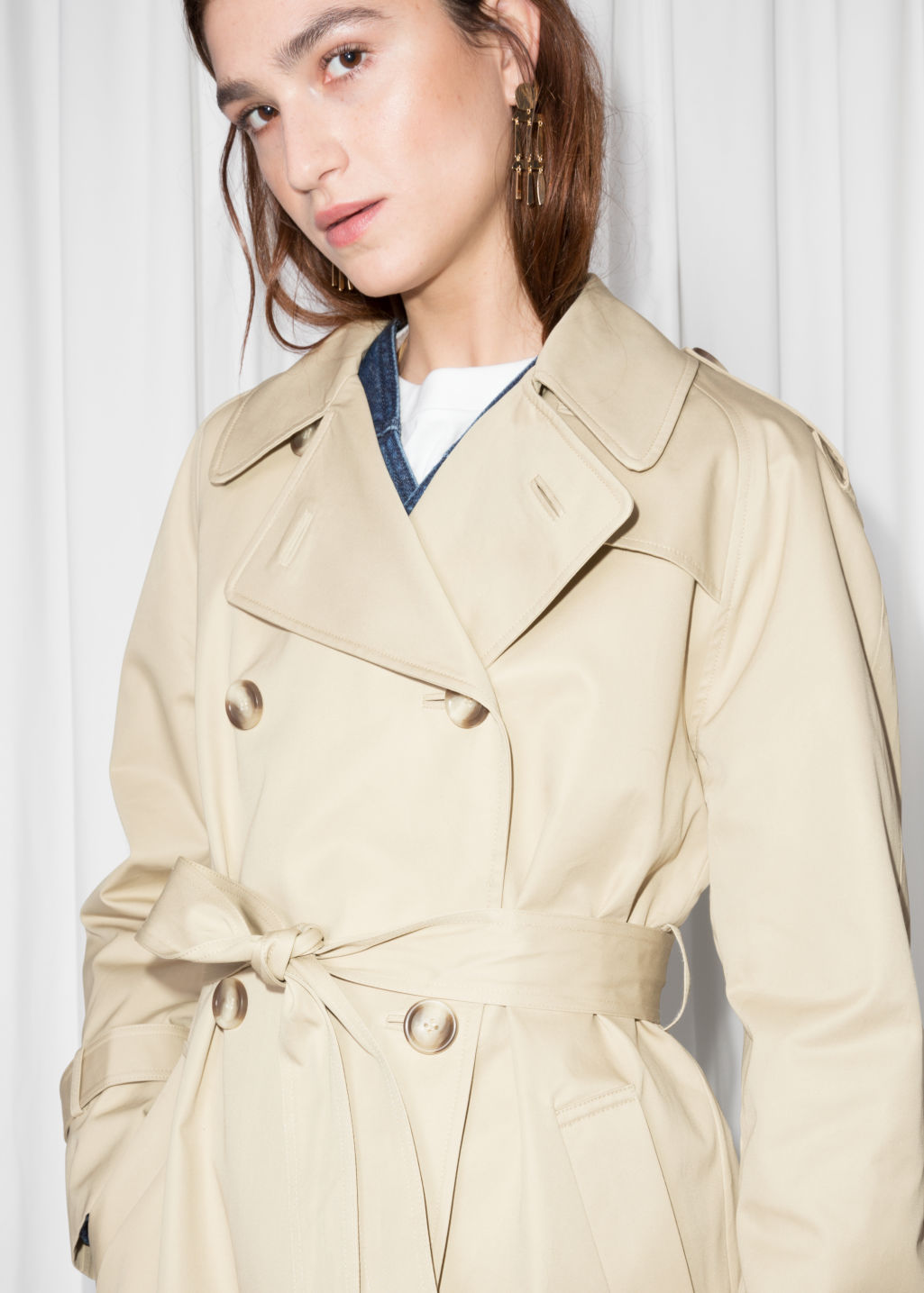 Detailed image of Stories belted trench coat  in beige