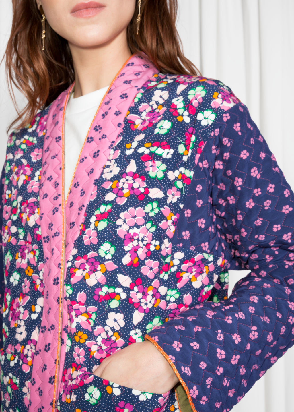 Detailed image of Stories floral print quilted jacket in blue