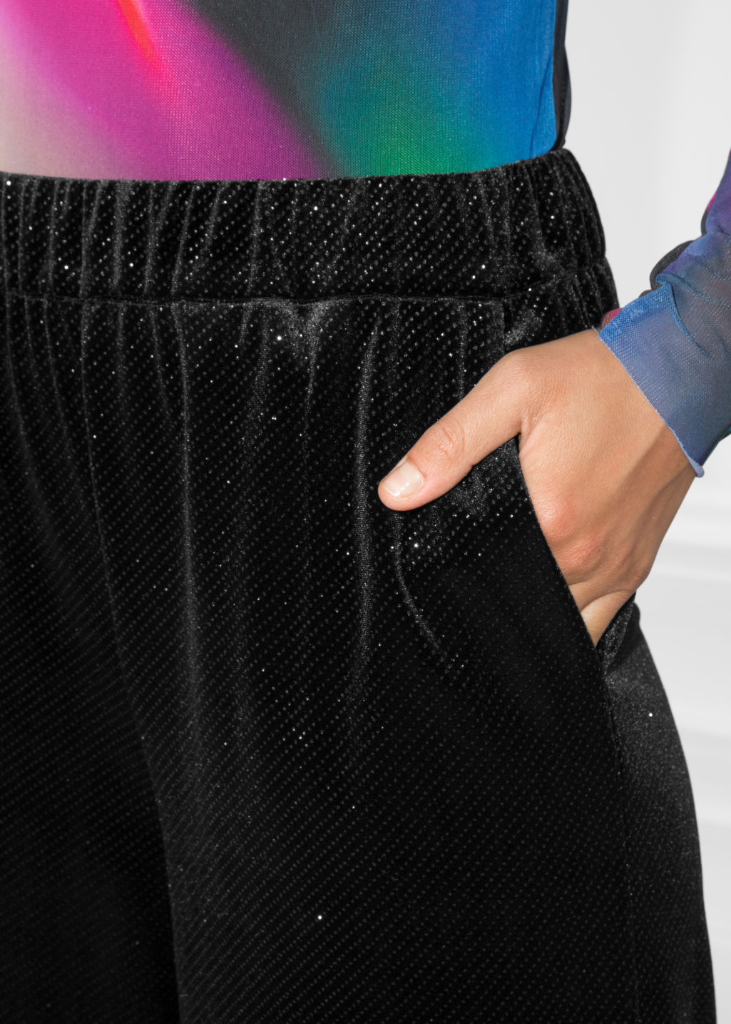 Detailed image of Stories sparkling velour trousers in black