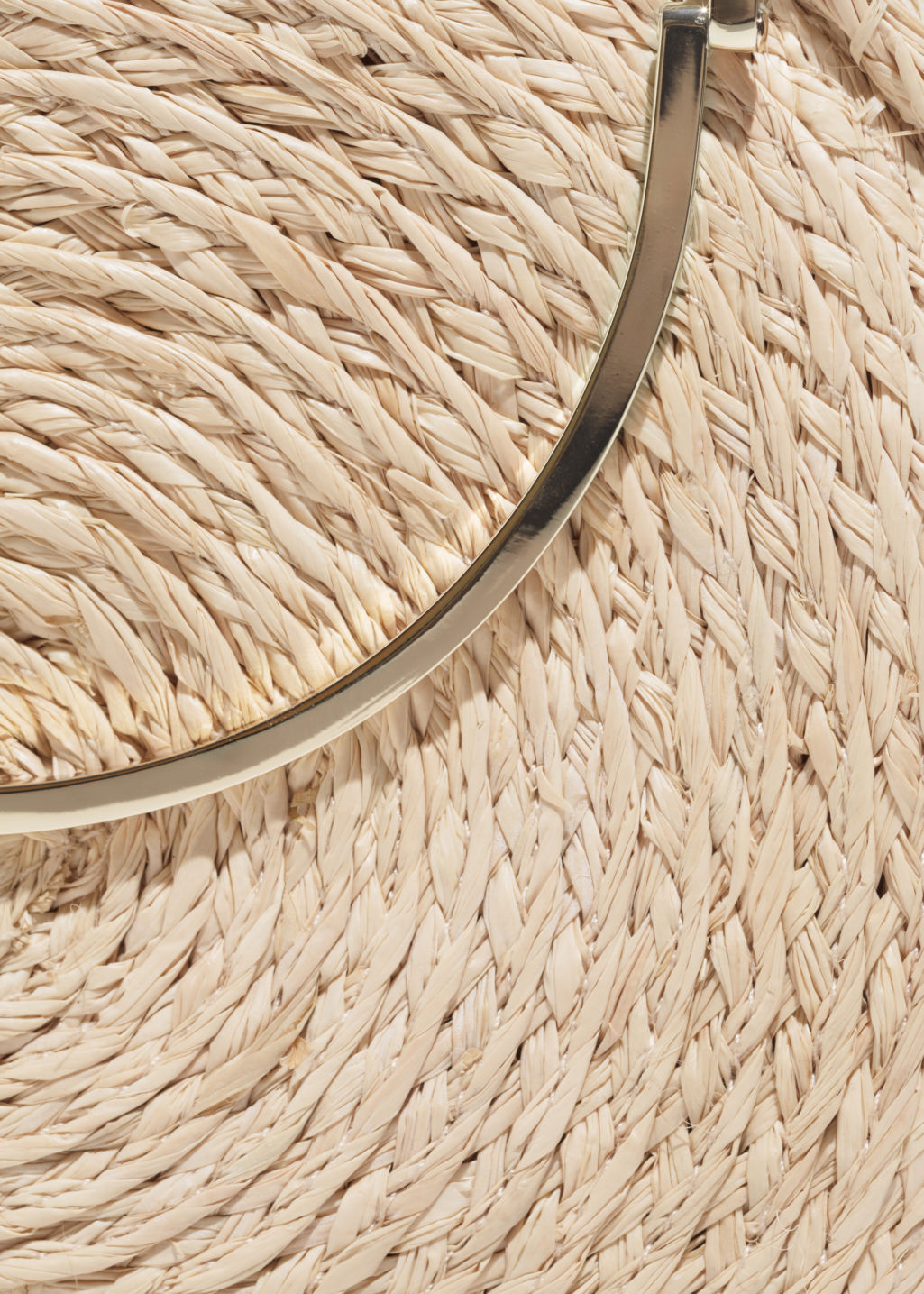 Detailed image of Stories straw circle crossbody in beige