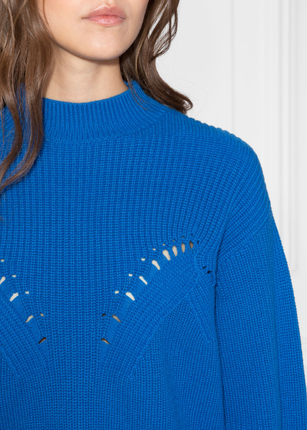 Detailed image of Stories slit sleeve sweater in blue