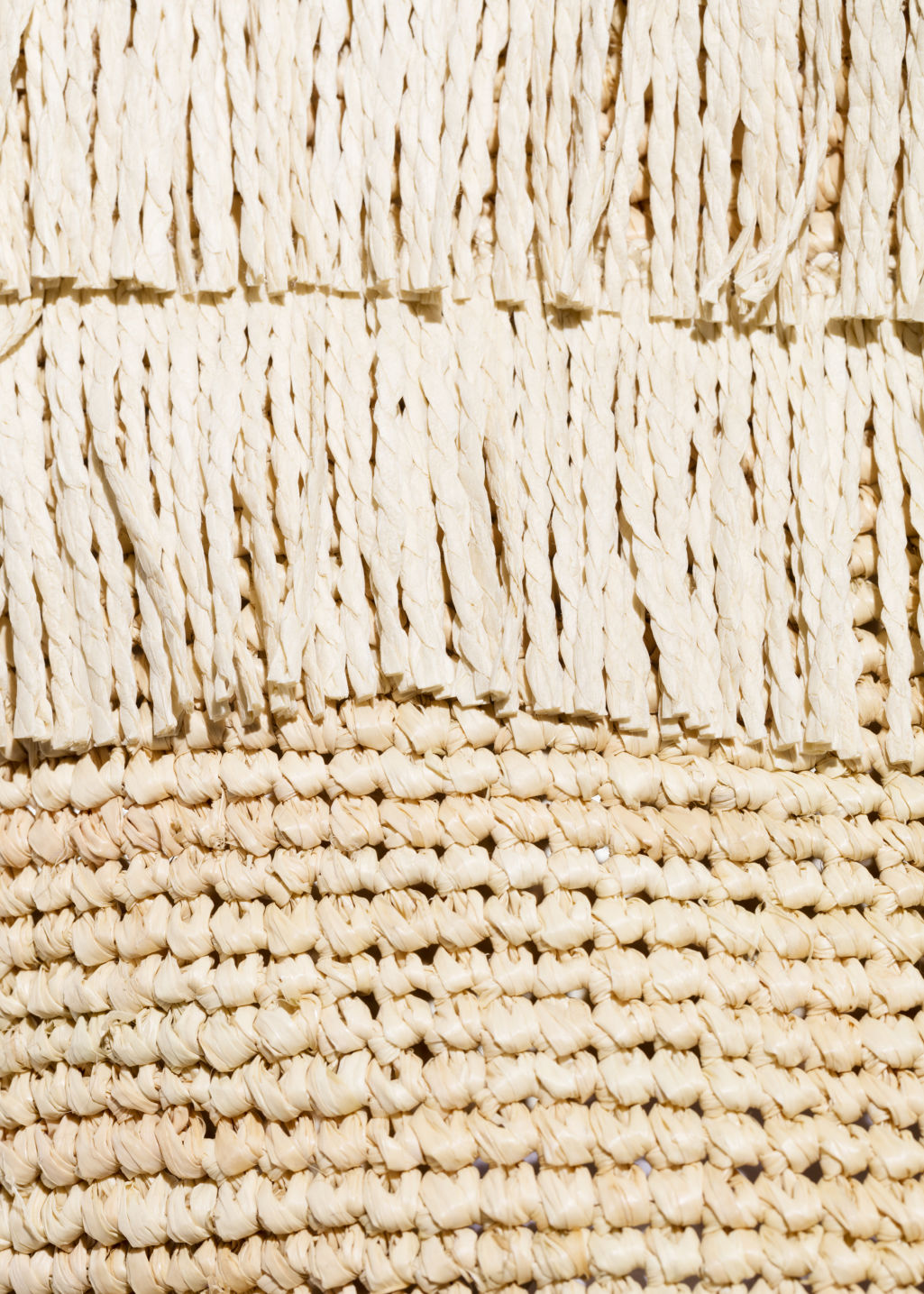 Detailed image of Stories woven straw bag in beige