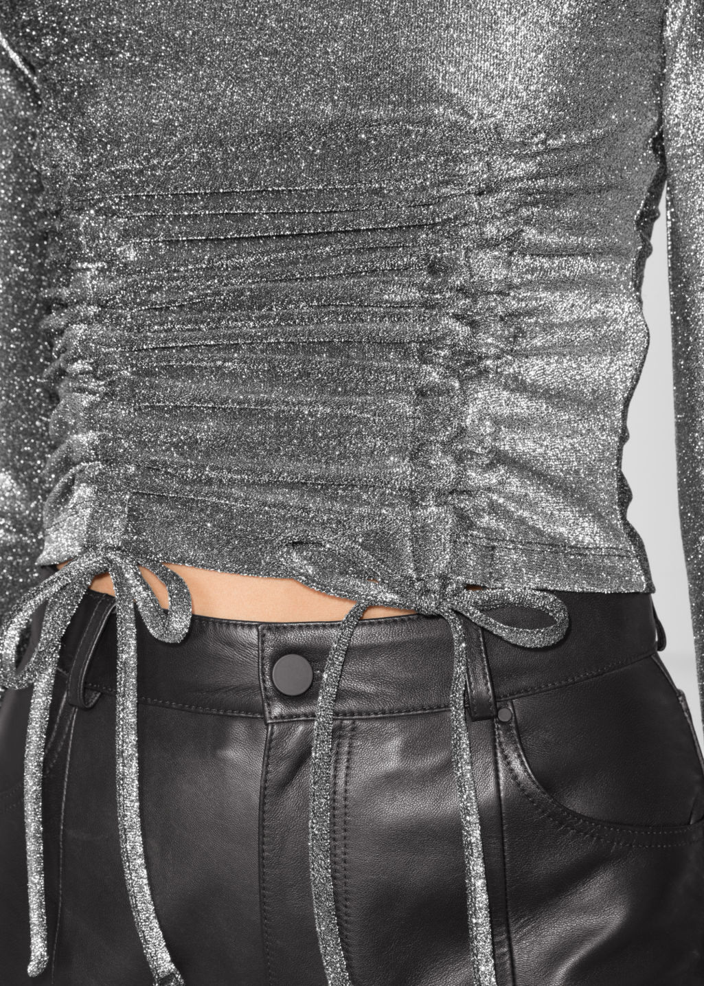Detailed image of Stories metallic drawstring top in silver