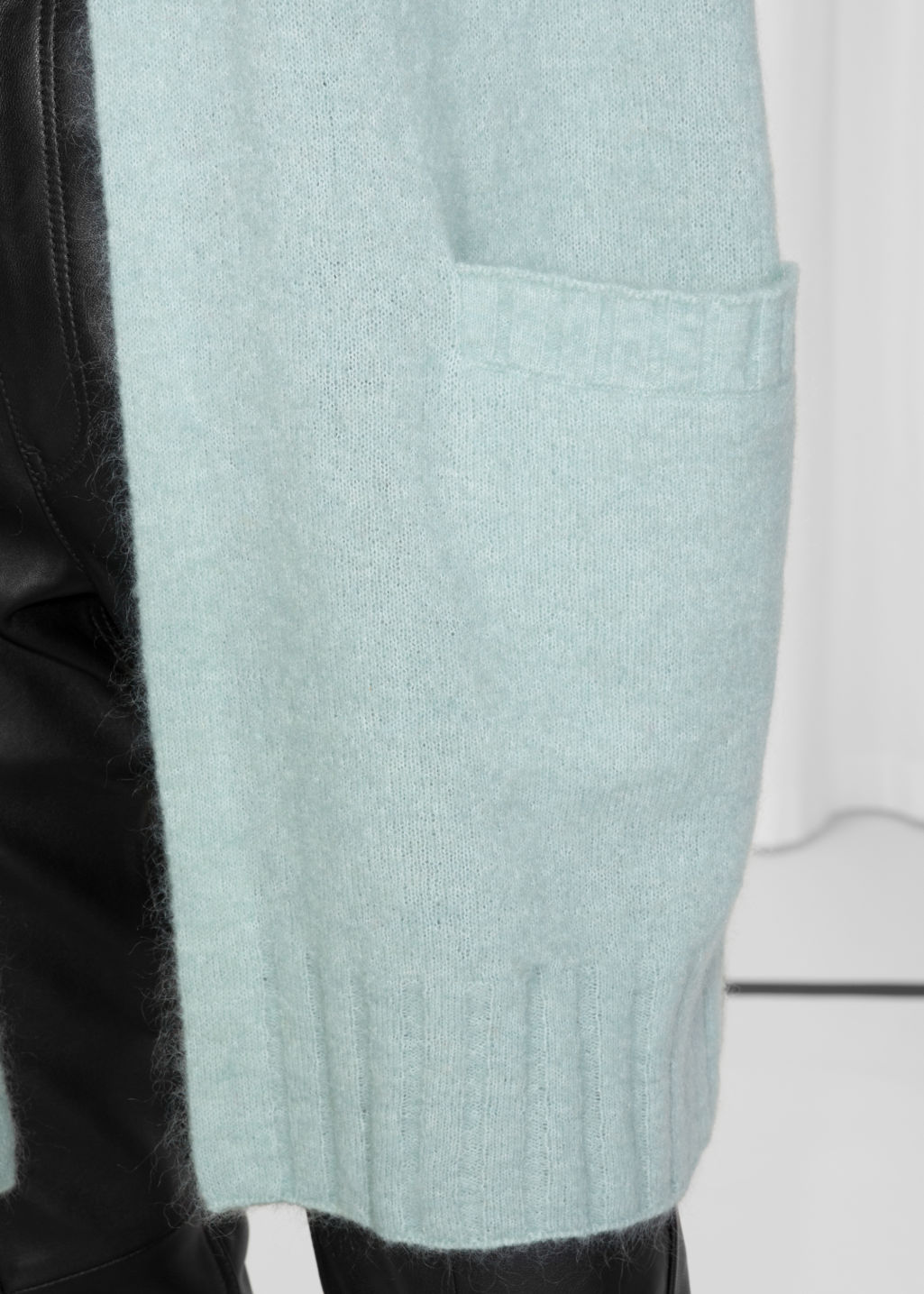 Detailed image of Stories mohair & wool oversized cardigan in turquoise