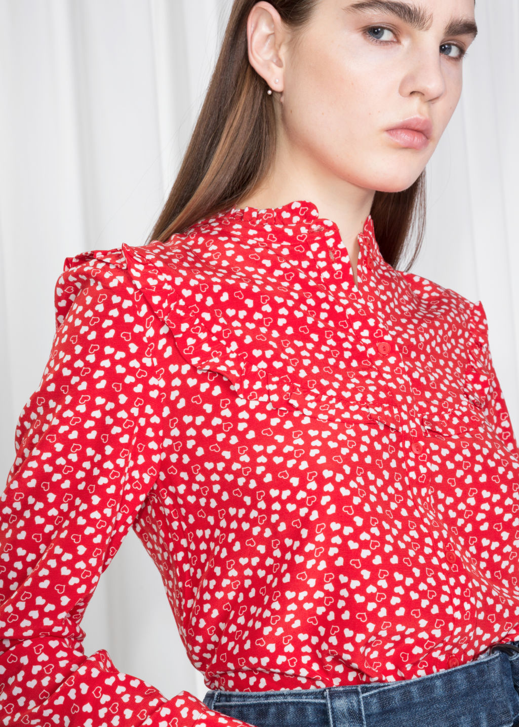 Detailed image of Stories heart print ruffle blouse  in red