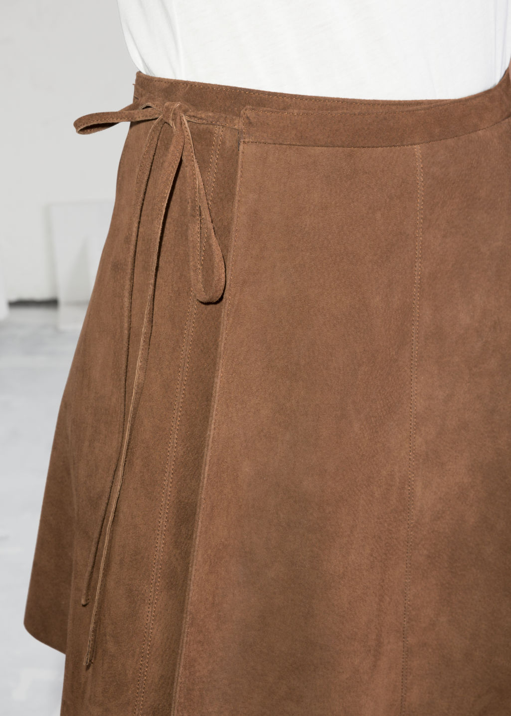 Detailed image of Stories wrap suede mini skirt in beige