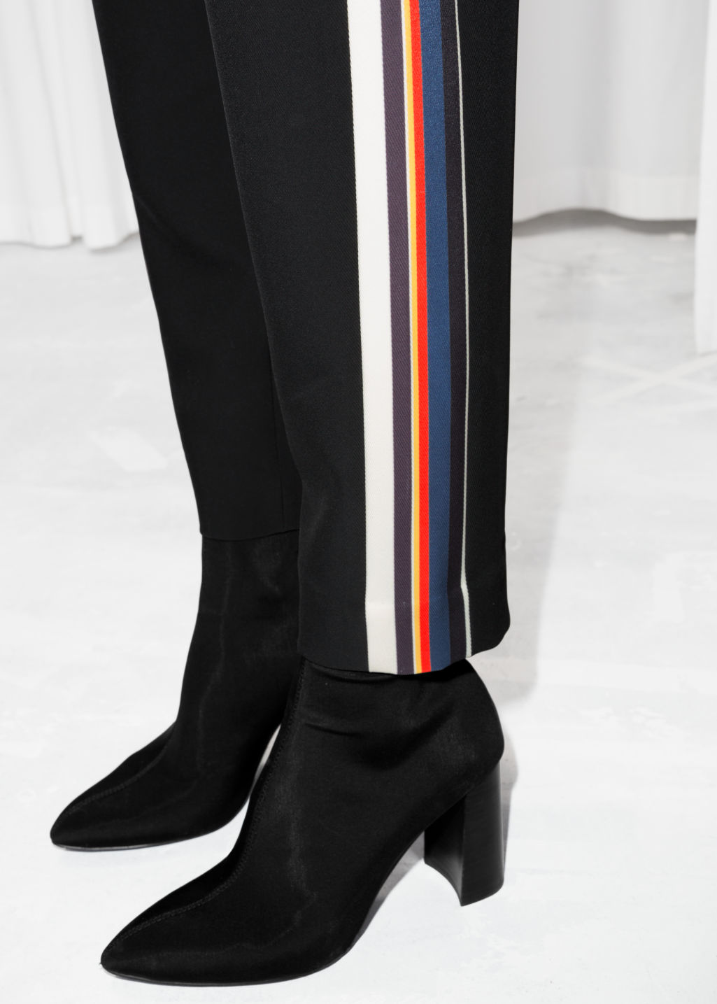 Detailed image of Stories tapered racer stripe trousers in black