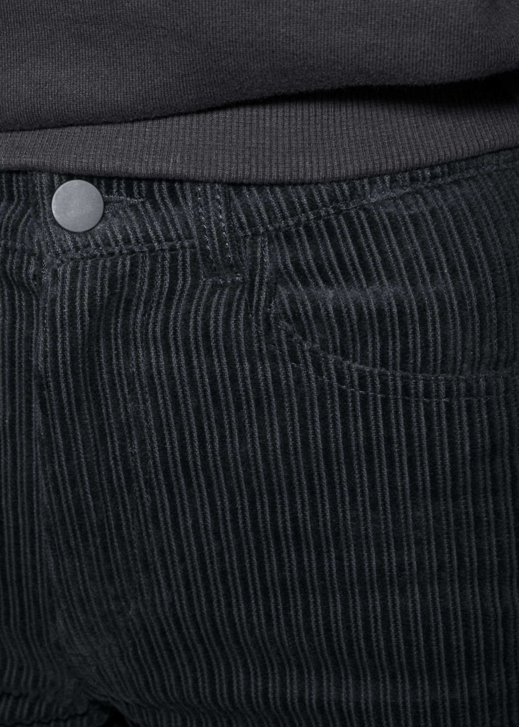 Detailed image of Stories cropped corduroy trousers in black