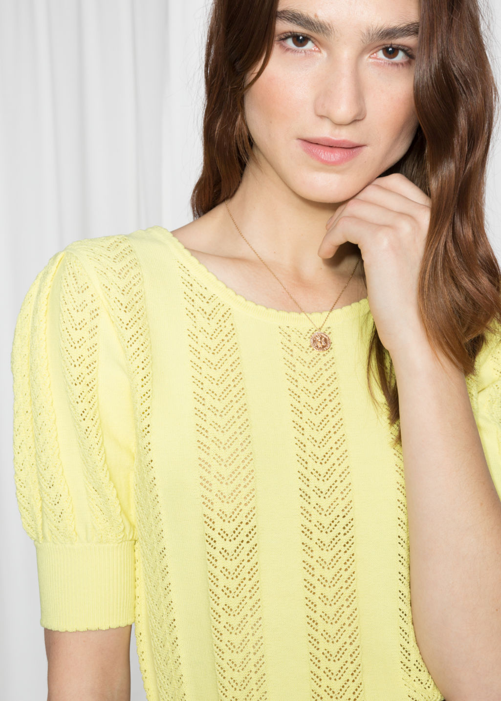 Detailed image of Stories eyelet knit top in yellow