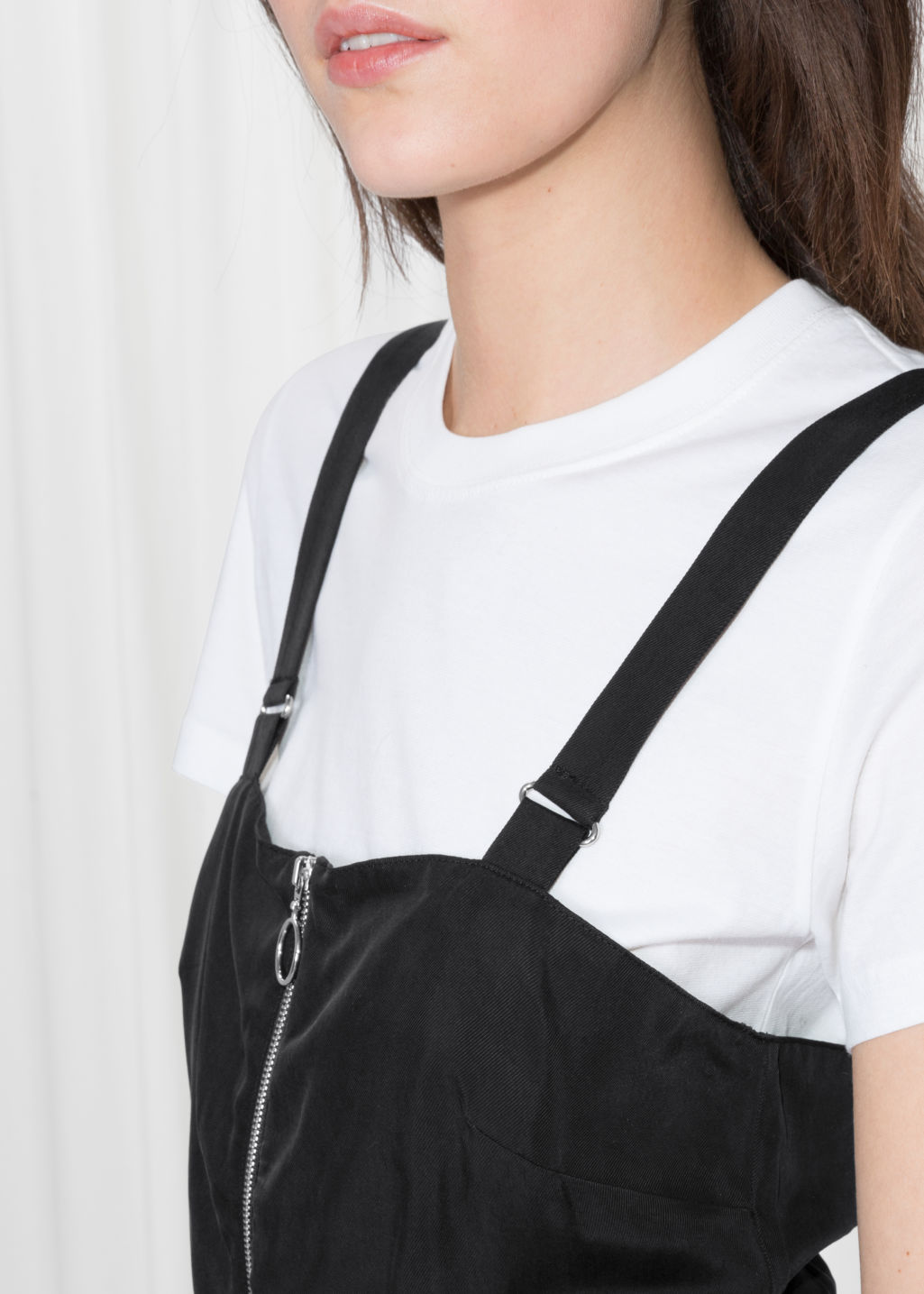 Detailed image of Stories front zip jumpsuit  in black