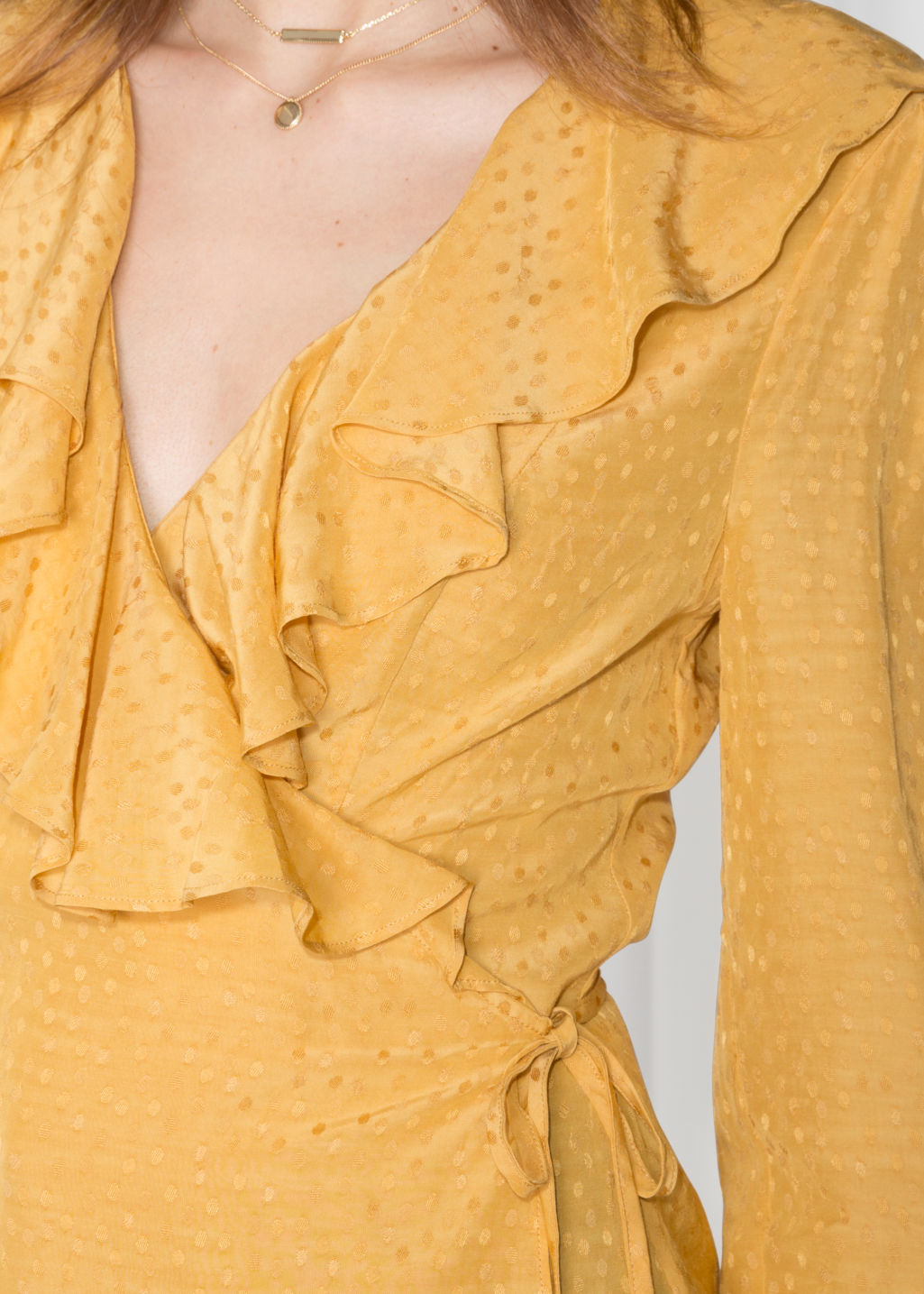 Detailed image of Stories ruffle wrap blouse in yellow