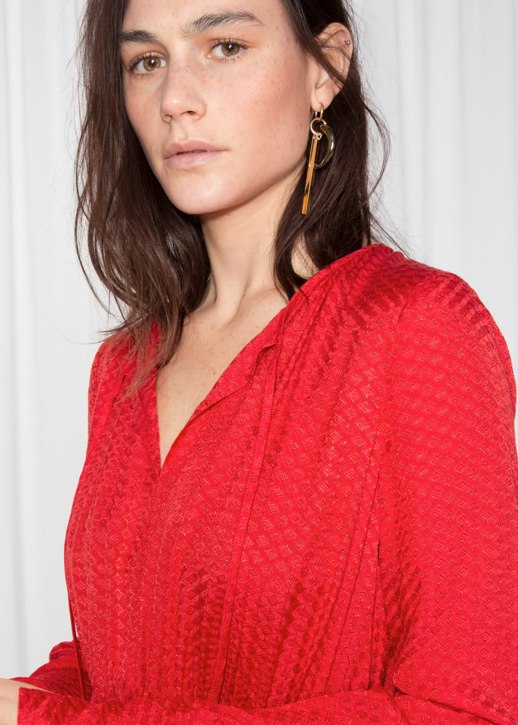 Detailed image of Stories midi tie neck dress in red