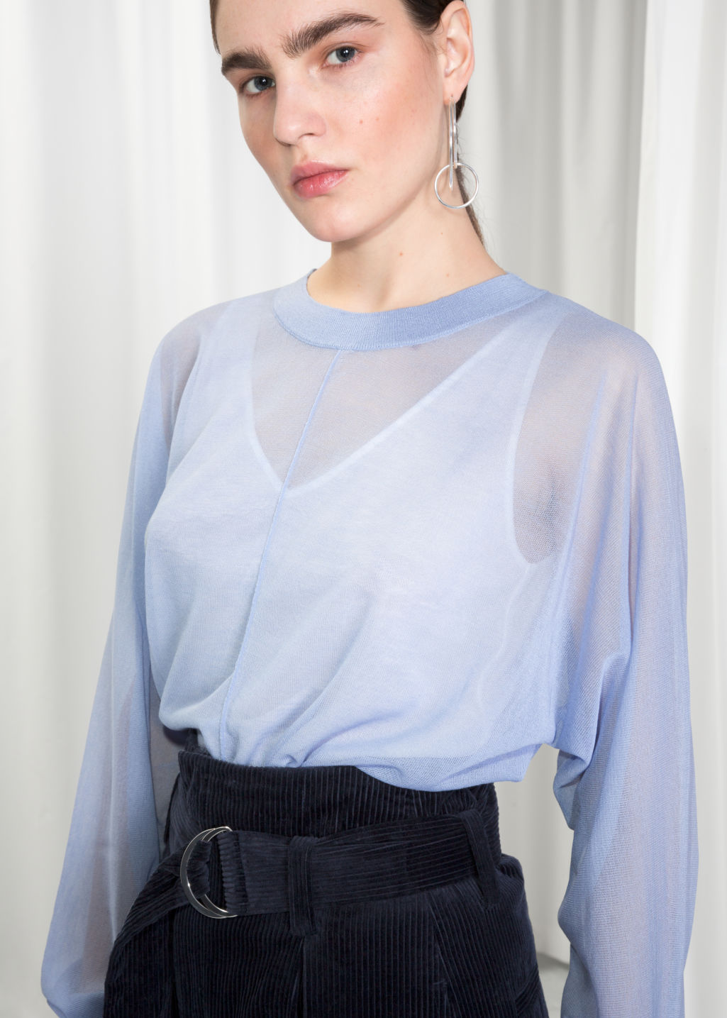 Detailed image of Stories sheer knit top  in blue