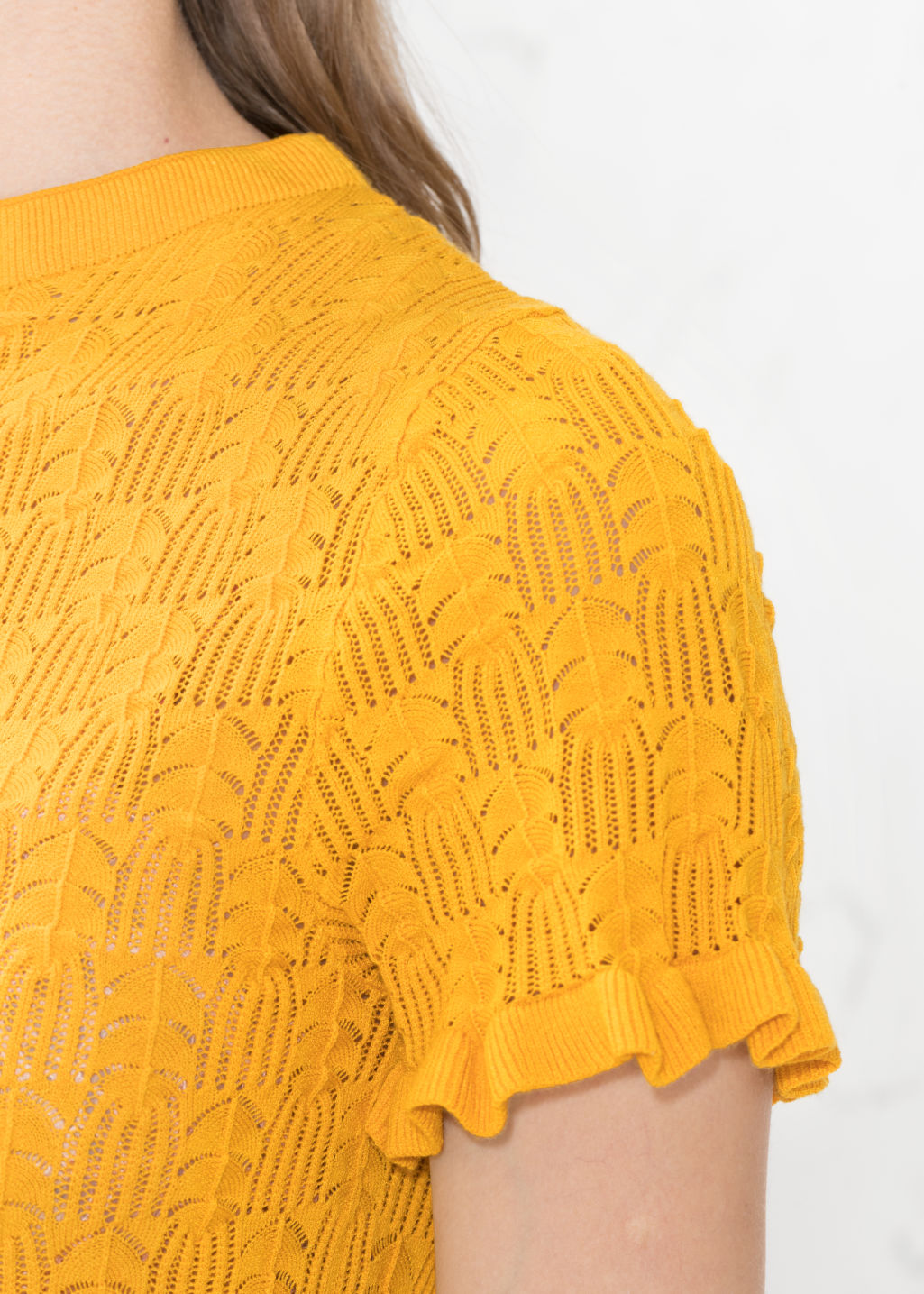 Detailed image of Stories ruffle knit top in yellow