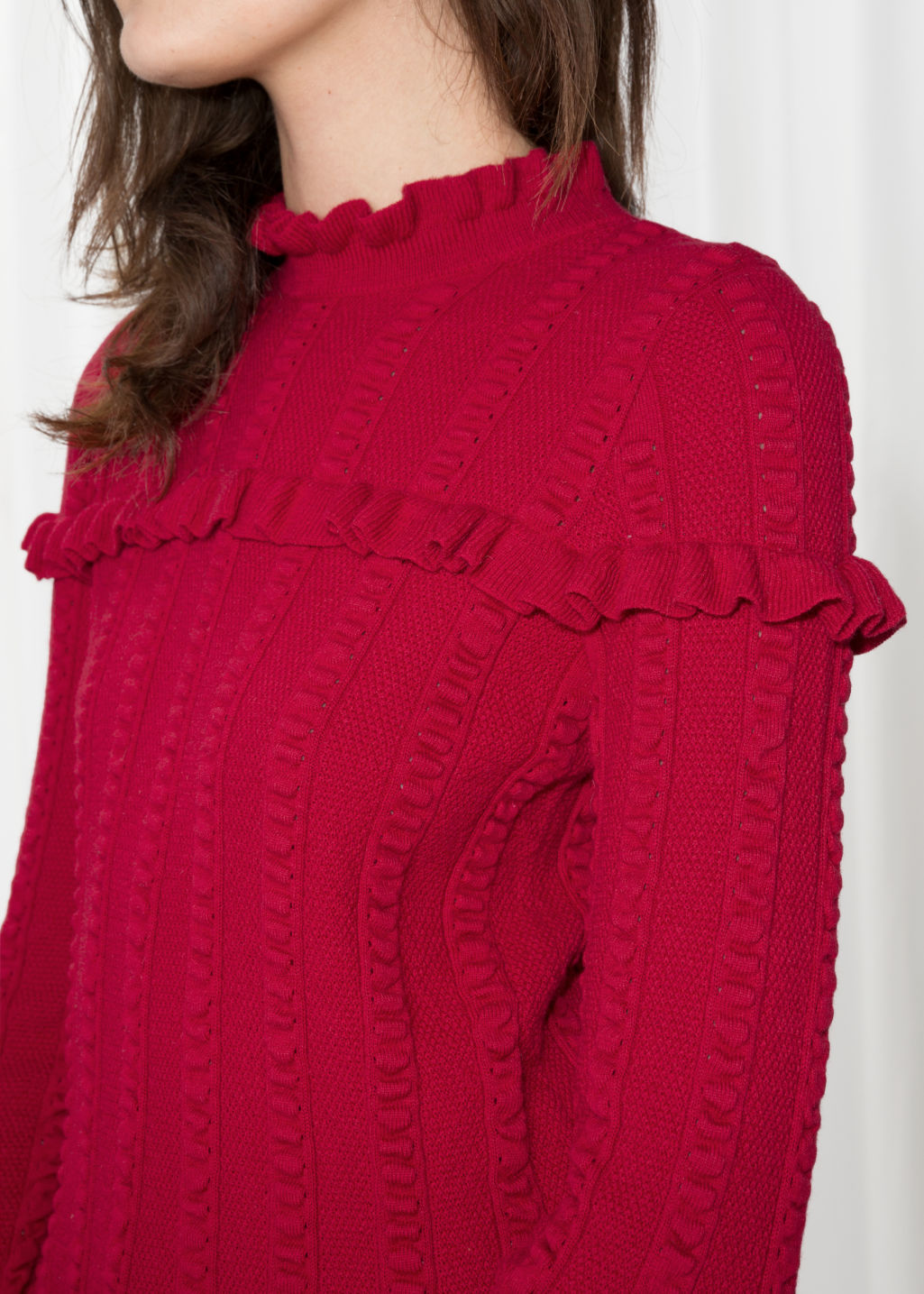 Detailed image of Stories ruffle knit sweater in red