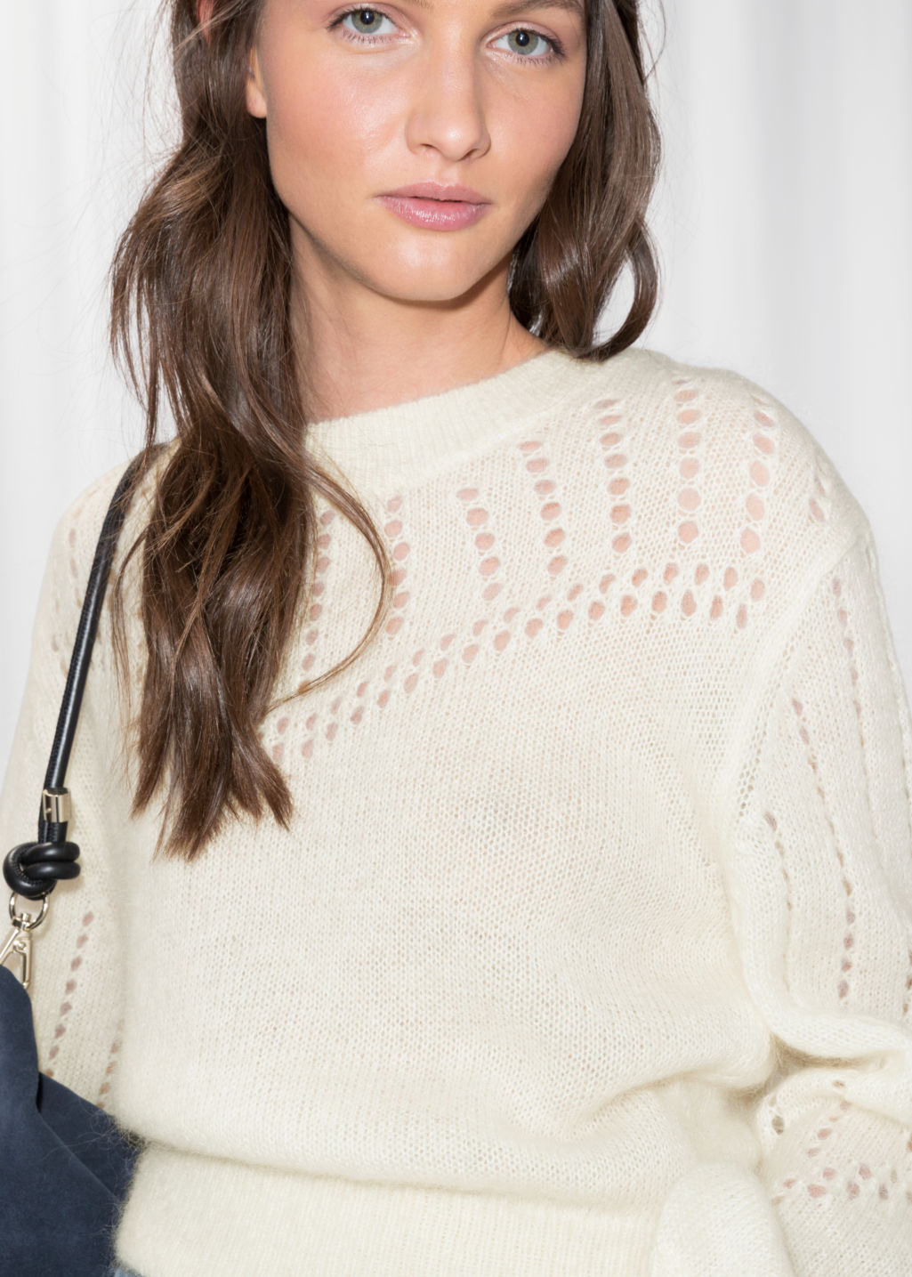 Detailed image of Stories eyelet knit sweater in white