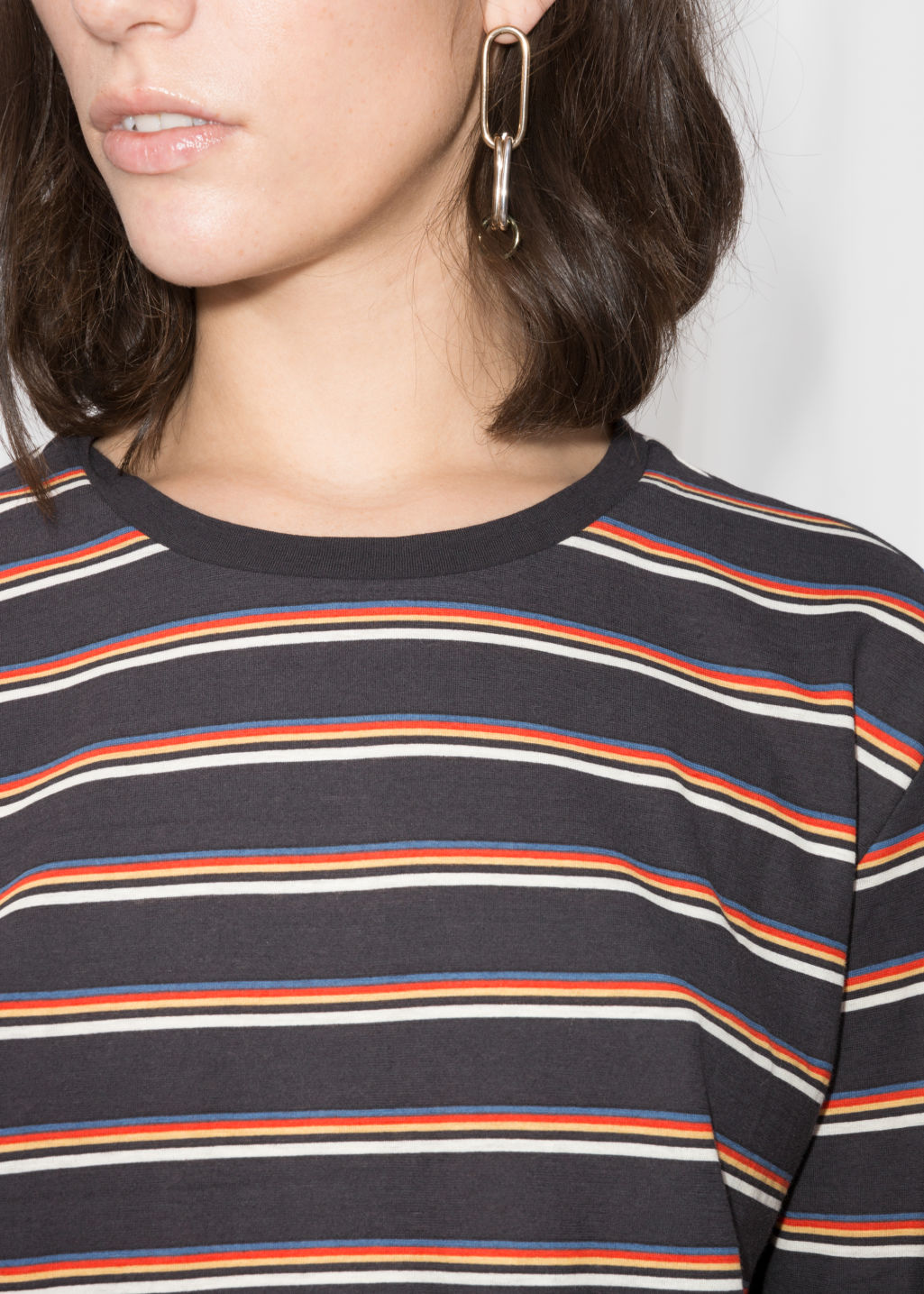 Detailed image of Stories cropped long sleeve shirt in black