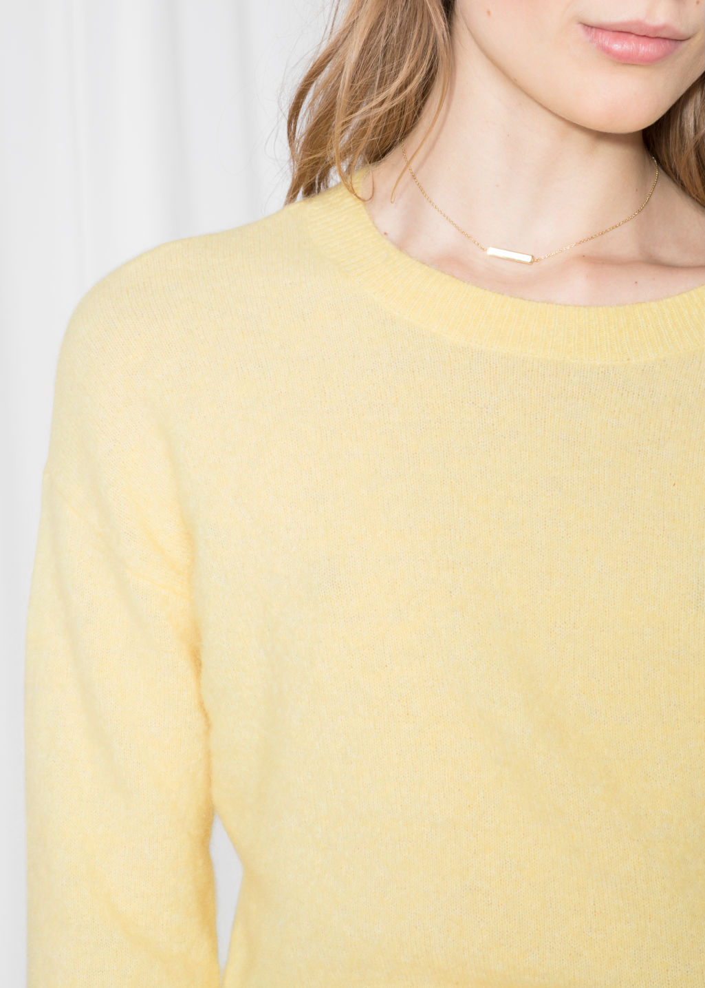 Detailed image of Stories fuzzy sweater in yellow
