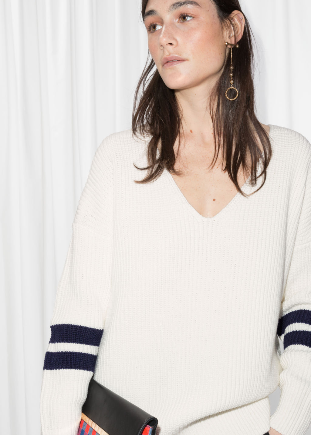 Detailed image of Stories boyfriend fit varsity sweater  in white