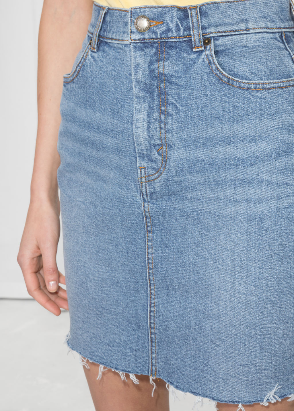 Detailed image of Stories raw hem denim pencil skirt  in blue