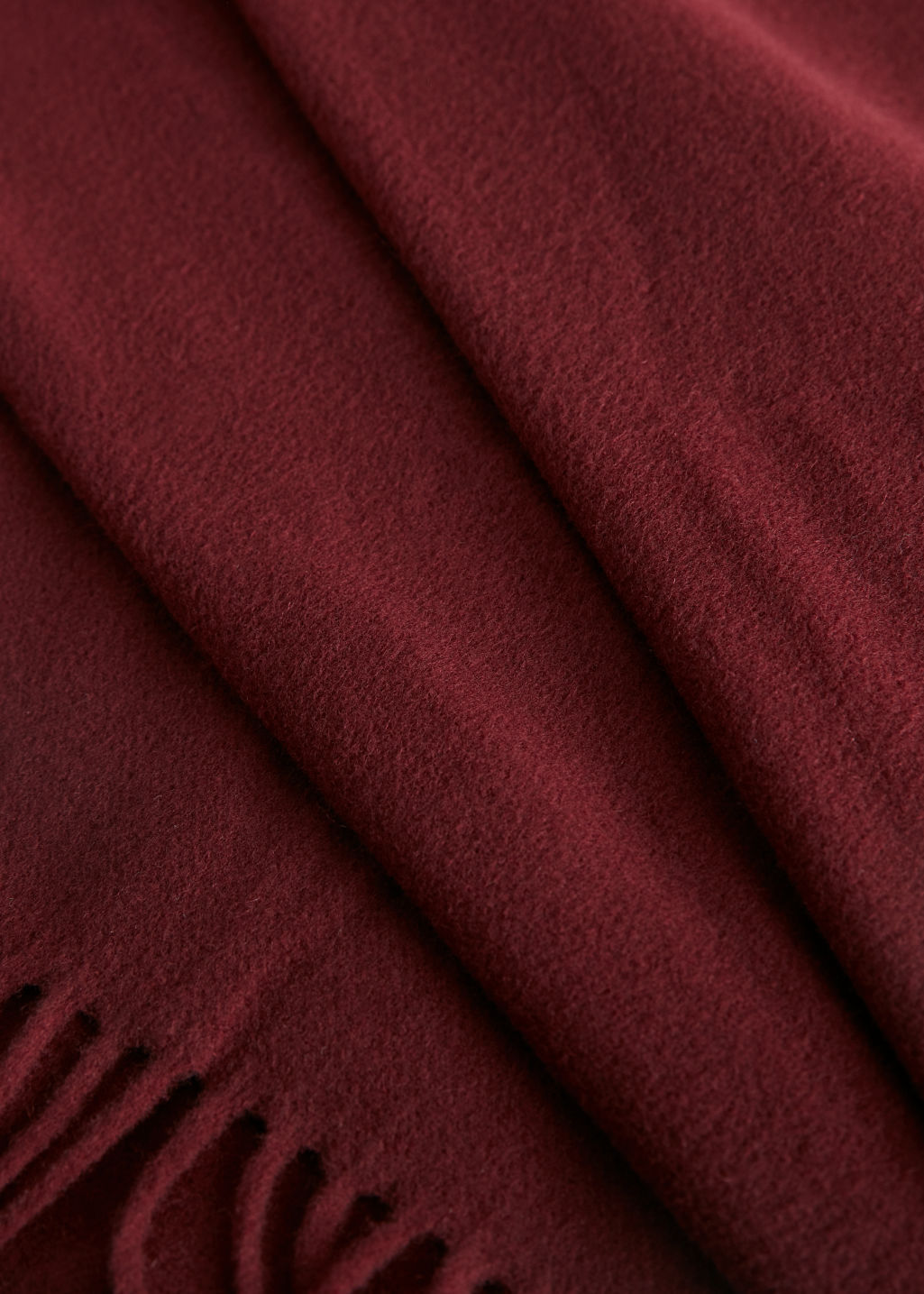Detailed image of Stories wool fringed blanket scarf in red