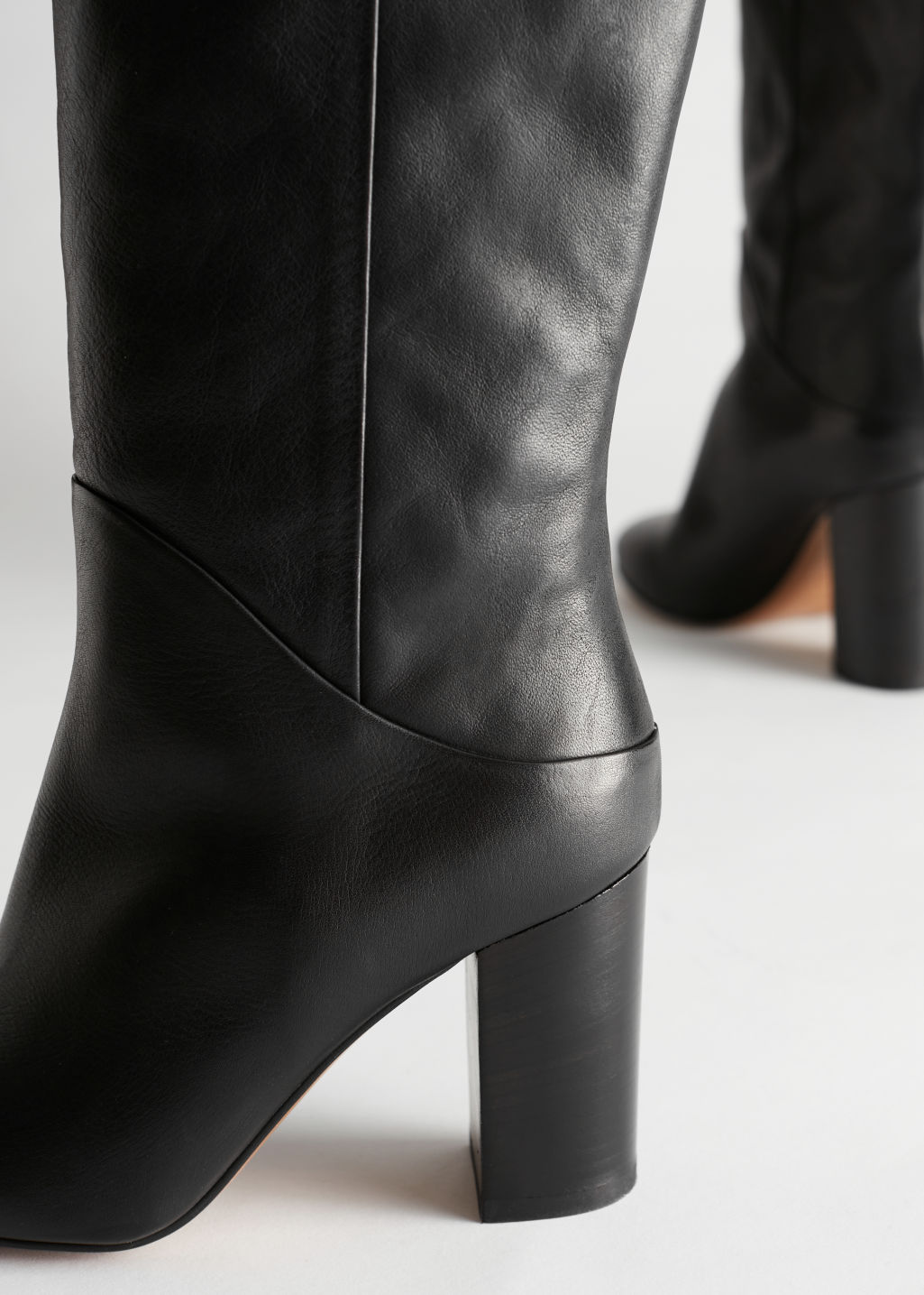 Detailed image of Stories soft leather block heel boots in black
