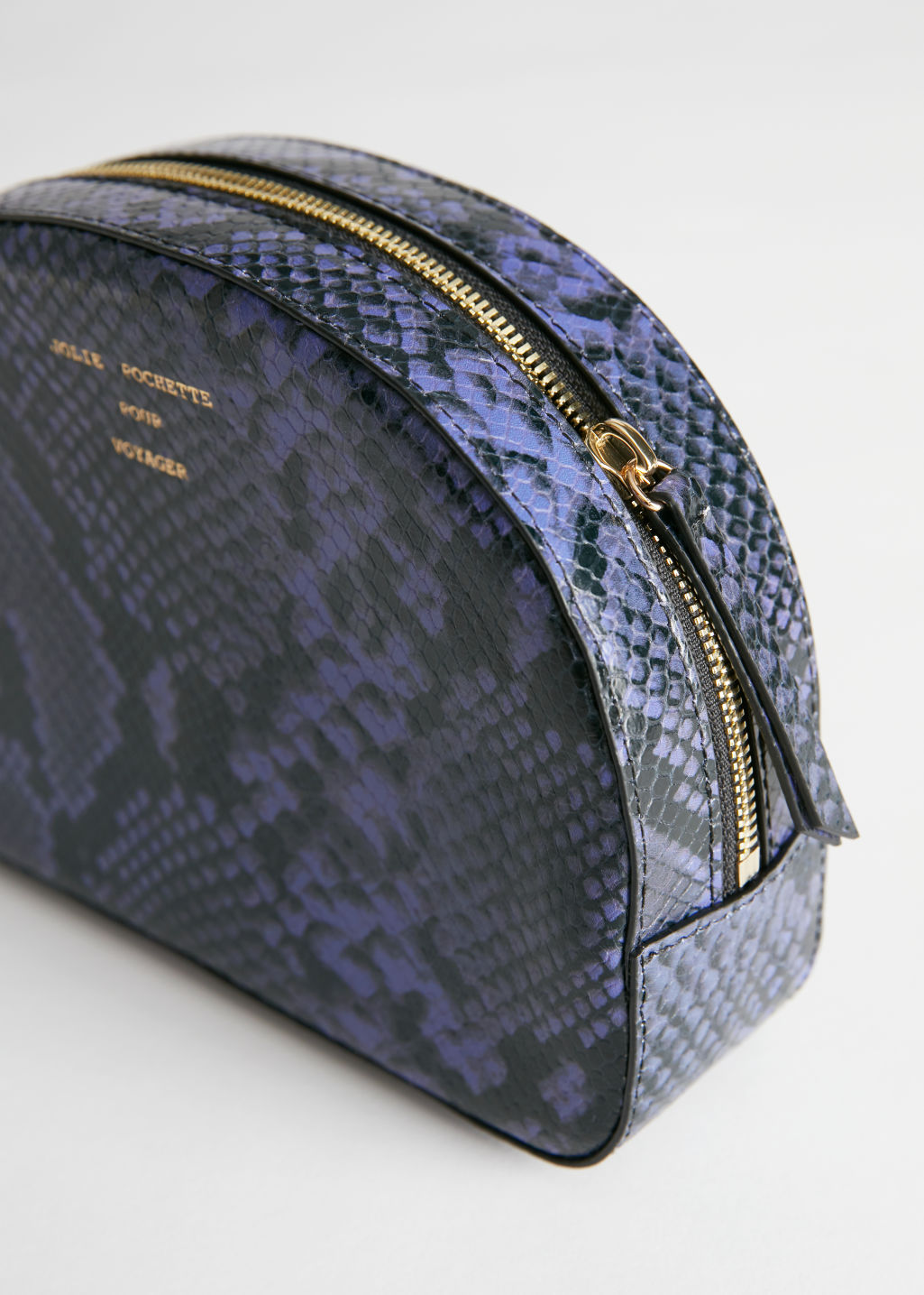 Detailed image of Stories half moon snake vanity bag in purple
